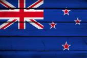 New Zealand Flag on wood background — Stock Photo