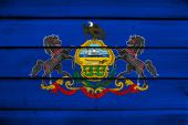 Pennsylvania State Flag on wood background — Stock Photo