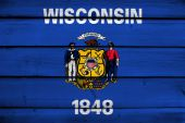 Wisconsin State Flag on wood background — Stock Photo