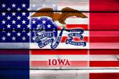 USA and Iowa State Flag on wood background — Stock Photo