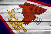 American Samoa Flag on wood background — Stock Photo