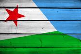 Bandera de yibuti sobre fondo de madera — Foto de Stock