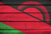 Malawi Flag on wood background — Stock Photo