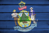 Maine State Flag on wood background — Stock Photo