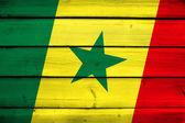 Senegal Flag on wood background — Stock Photo