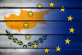 Cyprus and European Union Flag on wood background — Stock Photo