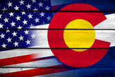 USA and Colorado State Flag on wood background — Stock Photo
