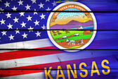 USA and Kansas State Flag on wood background — Stock Photo