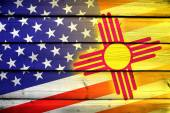 USA and New Mexico State Flag on wood background — Stock Photo