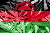 Malawi Flag on cannabis background. Drug policy. Legalization of marijuana — Stock Photo