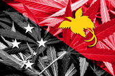 大麻の背景にパプア ニューギニアの旗。薬物政策。マリファナの合法化 — ストック写真