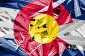 Colorado State Flag on cannabis background. Drug policy. Legalization of marijuana — Stock Photo