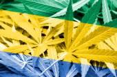Gabon Flag on cannabis background. Drug policy. Legalization of marijuana — Stock Photo