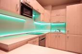 Modern luxury kitchen with green LED lighting — Stock Photo