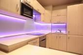 Modern luxury kitchen with pink LED lighting — Stock Photo