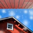 Typical norwegian red fishing hut with roof background — Stock Photo #58771917