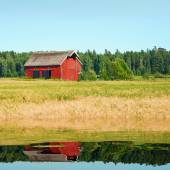 Beautiful nordic red house against the blue sky — Stock Photo