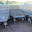 Rows of a plurality of shopping trolleys in a supermarket — Stock Photo #55984963
