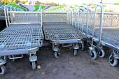 Rows of a plurality of shopping trolleys in a supermarket — Stock Photo