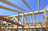 Installation of wooden beams at construction the roof truss syst — Stock Photo