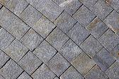 Pavement made of grey granite paving stones — Stock Photo