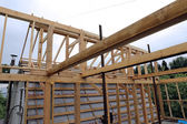 Installation of wooden beams at construction of the frame house — Stock Photo