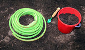 Horticulture accessories on the gardenbed — Stock Photo