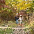 Two girls walking in the woods — Stock Photo #67988241