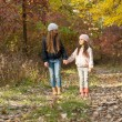 Two girls walking in the woods — Stock Photo #67988249