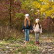 Two girls walking in the woods — Stock Photo #67988257