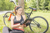 Smiling athletic woman laptop tablet computer after exercising, modern lifestyle concept. — Stockfoto
