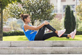 Athletic woman doing stretches in the street. — Stock Photo