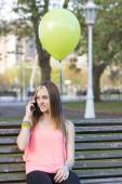 Smiling girl looking mesage on phone, happiness connecting people concept. — Stockfoto