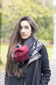 Beautiful young woman wearing scarf in the park. — Stock Photo