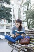 Happiness woman sitting on bench and reading book, outdoor. — Stock Photo