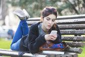 Girl reading message on phone, adolescense lifestile concept. — Stock Photo