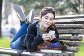 Girll looking message on phone, feeling, emotion concept. — Stock Photo