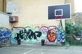 Basketball yard painted in graffiti — Stock Photo