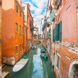 Gondolas parked next to buildings in Venice — Stock Photo #62356535