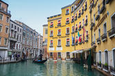 Gondola with tourists sailing in water canal — Stockfoto