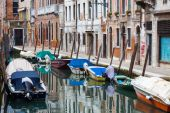 Gondolas moored along water channel — Stock Photo