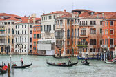 Gondolas sailing through water canal in Venice — Stockfoto