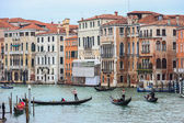 Water canal with gondolas in Venice — Stockfoto