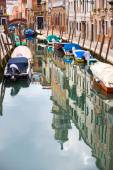 Empty gondolas moored in water canal — Stockfoto
