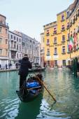 Gondola with tourists in water canal — Stock Photo