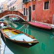 Gondolas parked in water canal — Stock Photo #63712593