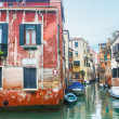 Boats parked in italian water canal — Stock Photo #63714691