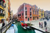Gondolas moored along water canal in Venice — Stock Photo