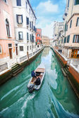Boat sailing in italian water channel — Stock Photo