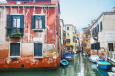 Boats parked in italian water canal — Stock Photo